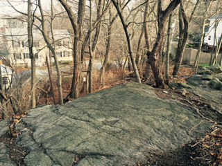 A view of the tablet like surface of Proctor's Ledge in Salem Massachusetts.